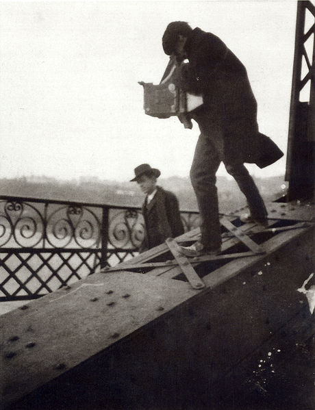 Alfred Stieglitz Photographing on a Bridge